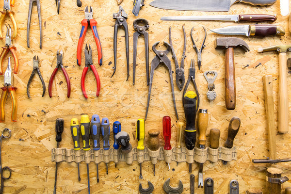 work tools hanging on wall at workshop Stock photo © dolgachov