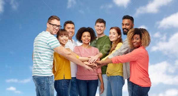 international group of happy people holding hands Stock photo © dolgachov