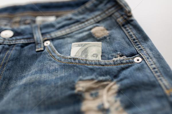 dollar money in pocket of denim pants or jeans Stock photo © dolgachov