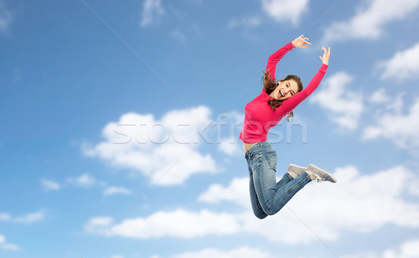 happy young woman jumping in air or dancing Stock photo © dolgachov