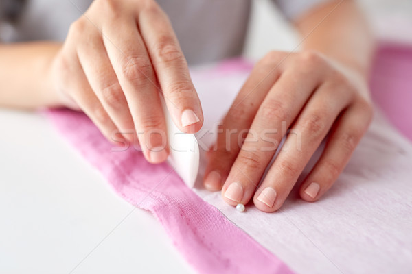 woman with pattern and chalk drawing on fabric Stock photo © dolgachov