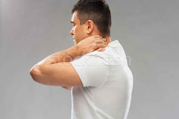 Człowiek cierpienie ból szyi ludzi opieki zdrowotnej Zdjęcia stock © dolgachov