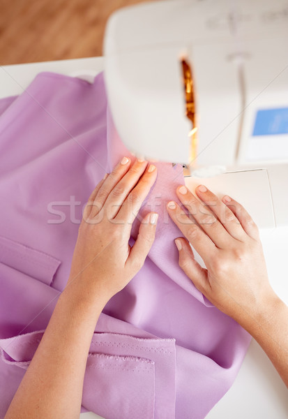 tailor woman with sewing machine stitching fabric Stock photo © dolgachov