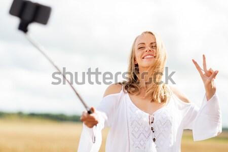 笑みを浮かべて 若い女性 白いドレス 青空 国 自然 ストックフォト © dolgachov