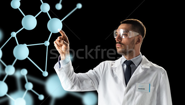 scientist in goggles with molecule projection Stock photo © dolgachov