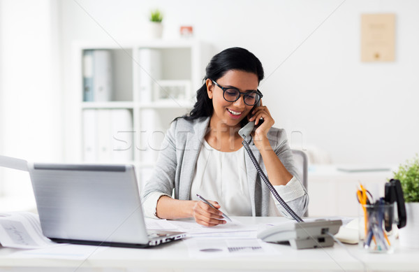 Feliz empresária chamada telefone escritório negócio Foto stock © dolgachov