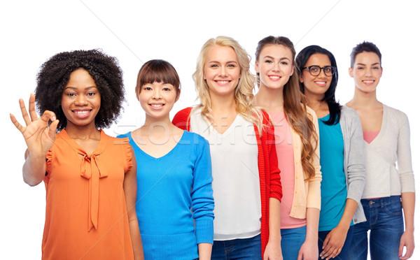 international group of happy women showing ok Stock photo © dolgachov
