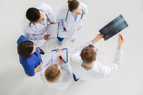 doctors with spine x-ray and clipboards Stock photo © dolgachov