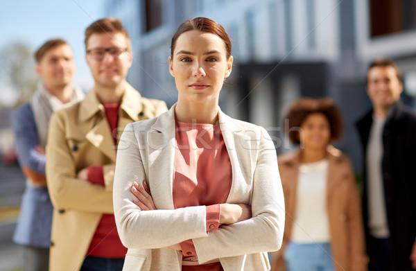 Donna internazionali squadra esterna uomini d'affari Foto d'archivio © dolgachov