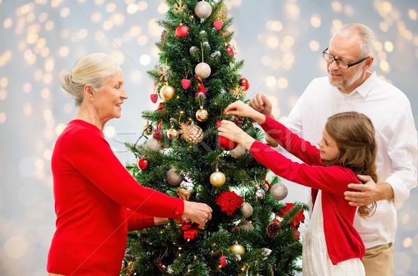 Nagyszülők leányunoka karácsonyfa tél ünnepek család Stock fotó © dolgachov