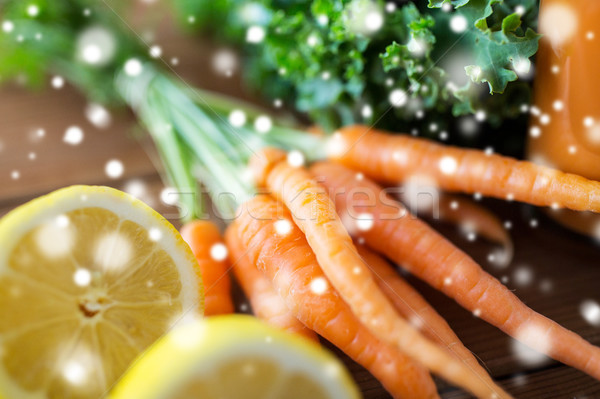 close up of carrot, lemon and lettuce Stock photo © dolgachov