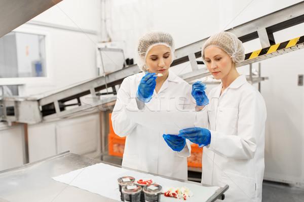 Donne degustazione gelato fabbrica alimentare produzione Foto d'archivio © dolgachov