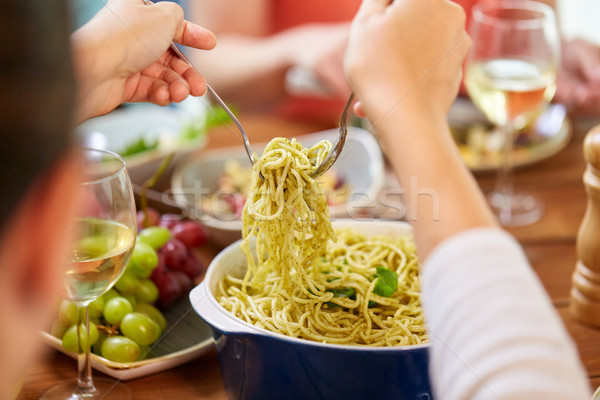 pasta with basil in bowl and other food on table Stock photo © dolgachov
