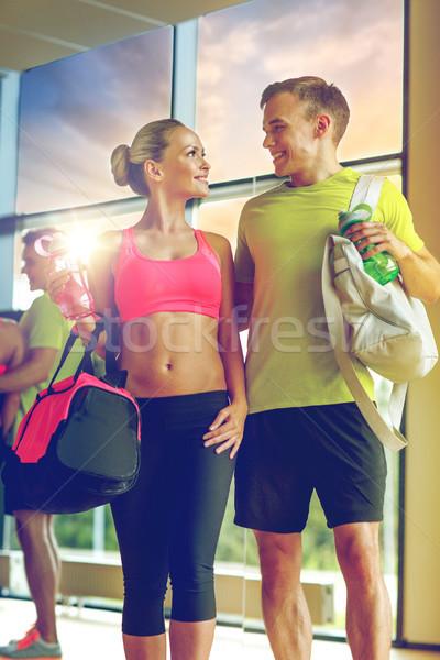 улыбаясь пару воды бутылок спортзал спорт Сток-фото © dolgachov