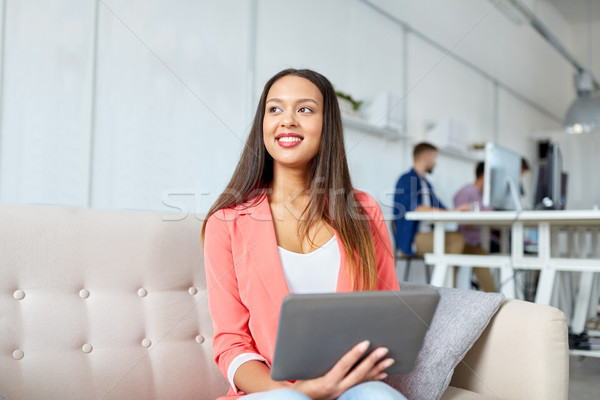 happy asian woman with tablet pc working at office Stock photo © dolgachov
