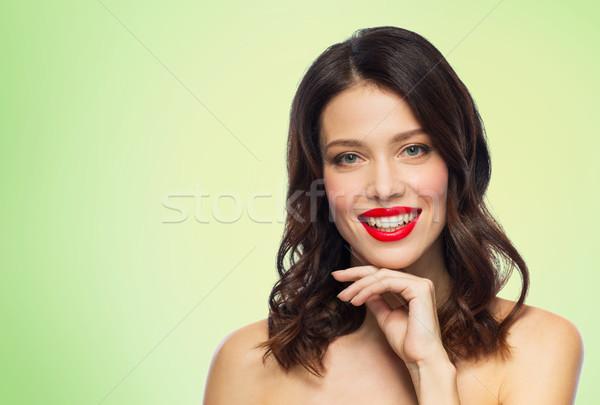 Güzel gülen genç kadın kırmızı ruj güzellik makyaj Stok fotoğraf © dolgachov
