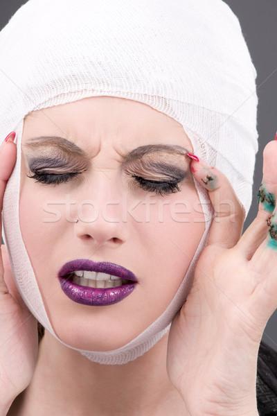 Sérülés kép szenvedés női arc szürke kezek Stock fotó © dolgachov