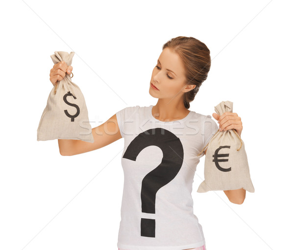 woman with dollar and euro signed bags Stock photo © dolgachov