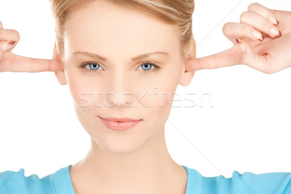 woman closing her ears with fingers Stock photo © dolgachov