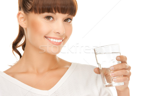 young smiling woman with glass of water Stock photo © dolgachov