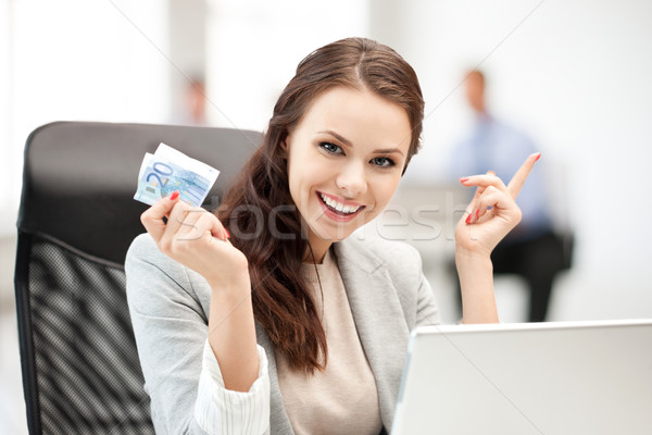 pensive businesswoman with cash money Stock photo © dolgachov