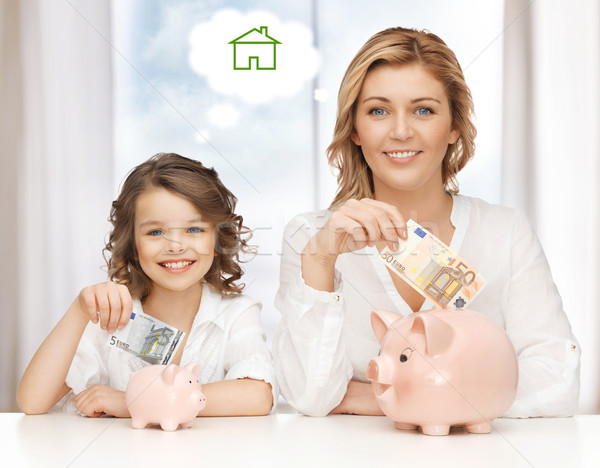 mother and daughter saving money Stock photo © dolgachov