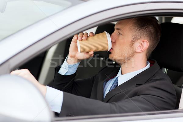 Man drinken koffie rijden auto vervoer Stockfoto © dolgachov