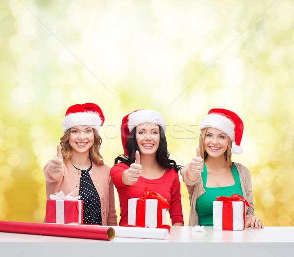 笑みを浮かべて 女性 サンタクロース ヘルパー ギフトボックス ストックフォト © dolgachov
