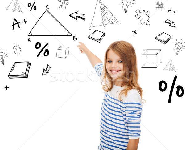 girl pointing to triangle on virtual screen Stock photo © dolgachov