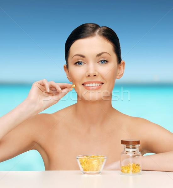 Gyönyörű nő omega 3 vitaminok egészségügy szépség nő Stock fotó © dolgachov