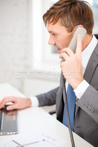 businessman with laptop computer and phone Stock photo © dolgachov