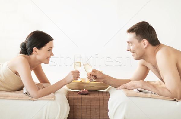 Casal estância termal quadro salão potável champanhe Foto stock © dolgachov