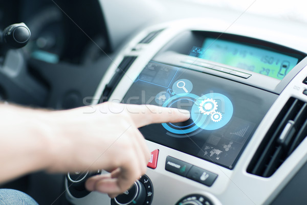 man using car control panel Stock photo © dolgachov