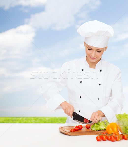 Gülen kadın şef pişirme gıda Stok fotoğraf © dolgachov
