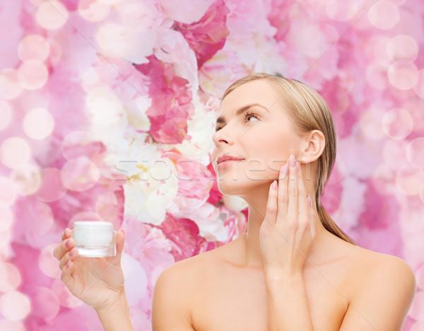woman applying cream on her skin Stock photo © dolgachov