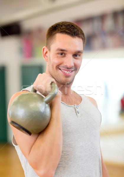 笑みを浮かべて 男 ケトルベル ジム フィットネス スポーツ ストックフォト © dolgachov