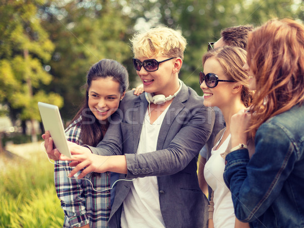 teenagers taking photo with tablet pc outside Stock photo © dolgachov