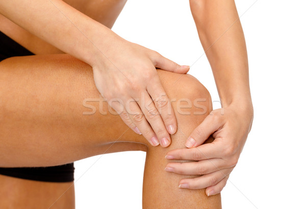 close up of female hands holding knee Stock photo © dolgachov