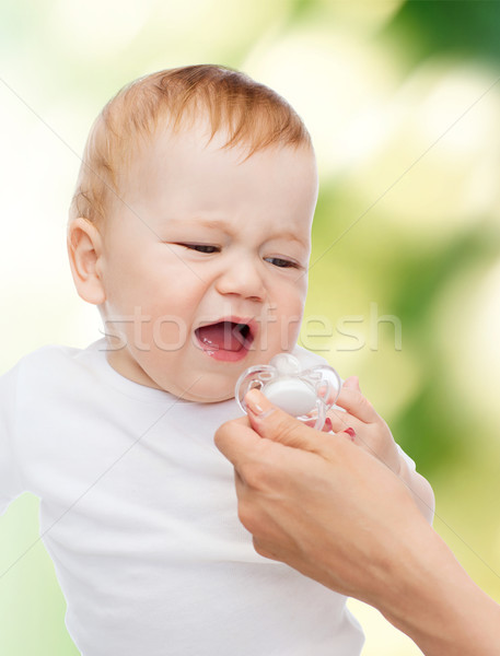 crying baby with dummy Stock photo © dolgachov