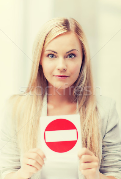 woman with no entry sign Stock photo © dolgachov