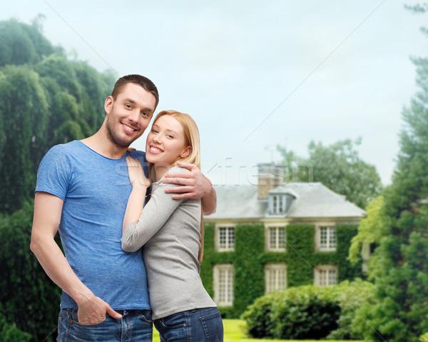 smiling couple hugging Stock photo © dolgachov