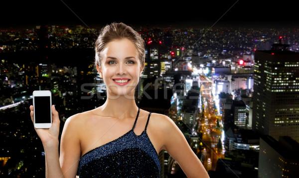 Сток-фото: улыбающаяся · женщина · вечернее · платье · смартфон · технологий · связи · реклама
