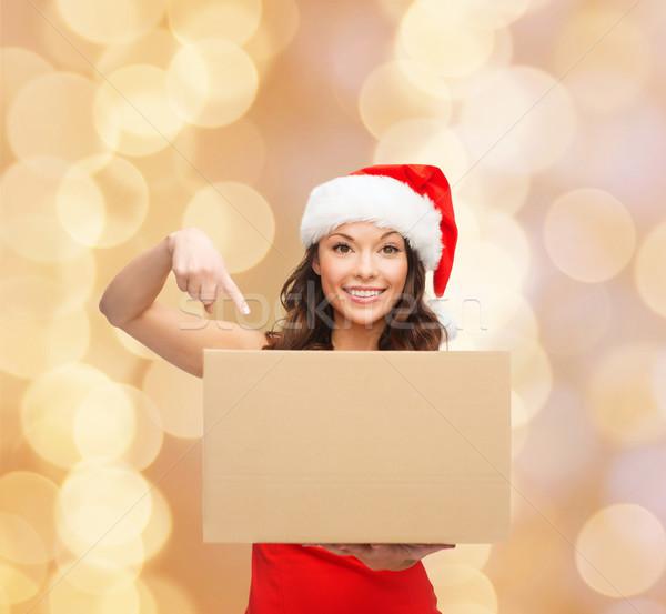 Uśmiechnięta kobieta Święty mikołaj pomocnik hat polu Zdjęcia stock © dolgachov