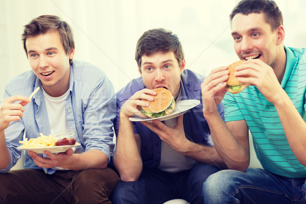 Glimlachend vrienden soda home vriendschap Stockfoto © dolgachov
