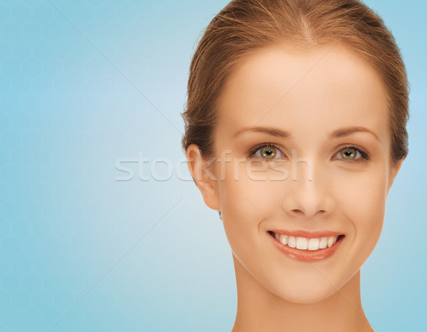 Stock photo: beautiful young woman over blue background