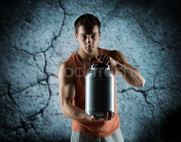 Jóvenes masculina jar proteína Foto stock © dolgachov