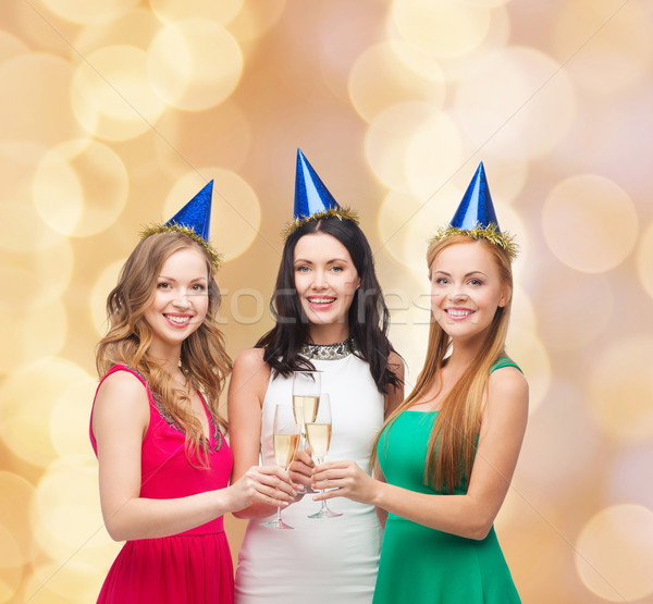 smiling women holding glasses of sparkling wine Stock photo © dolgachov