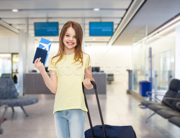Stock photo: smiling girl with travel bag ticket and passport