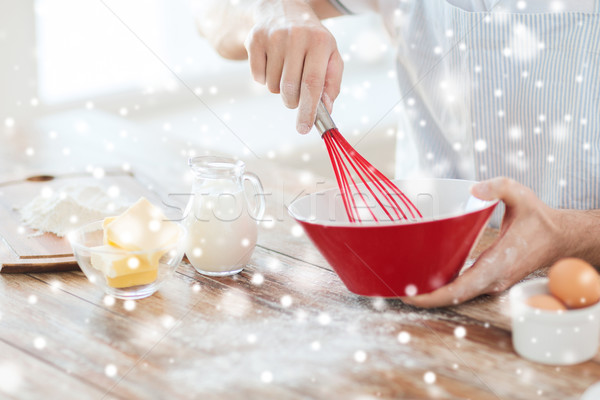 close up of man whipping something in bowl Stock photo © dolgachov