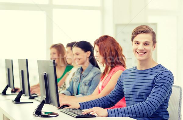 Maschio studente computer classe istruzione Foto d'archivio © dolgachov